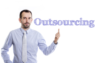 Outsourcing - Young businessman with small beard pointing up in blue shirt